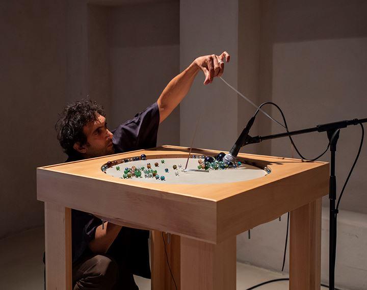 Tarek Atoui performing at the opening of Tarek Atoui: Cycles in 11. Sharjah Art Foundation, 2020