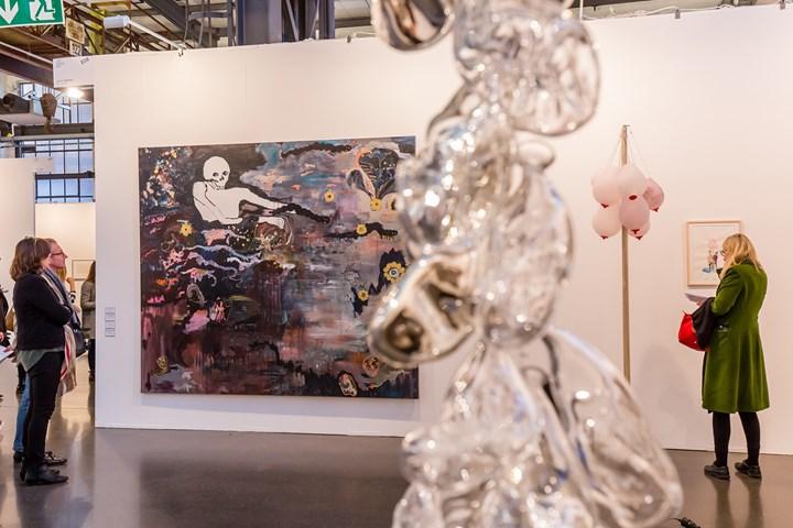 Los Carpinteros, It's Not Che, It's Angela Merkel (2014). Powder coated aluminium, LED lights. 170 x 120 cm; Babel Gris (2017). Watercolour on paper. 214.5 x 243 cm; Vlassis Caniaris, Garbage Child 4 (1974). Exhibition view: Galere Peter Kilchmann, Art Düsseldorf (17–19 November 2017). Courtesy Ocula. Photo: Stephanie Bailey.
