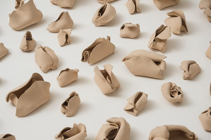 Hannah Wilke, 'Untitled' (1974–1977). Detail. Signed and dated. 103 terracotta sculptures 6.5 x 5.8 x 4.6 cm each; 2.5 x 152.4 x 152.4 cm board. © Marsie, Emanuelle, Damon and Andrew Scharlatt, Hannah Wilke Collection & Archive, Los Angeles. Licensed by VAGA, New York, NY/ DACS, London. Courtesy Alison Jacques Gallery, London and Hannah Wilke Collection and Archive, Los Angeles.