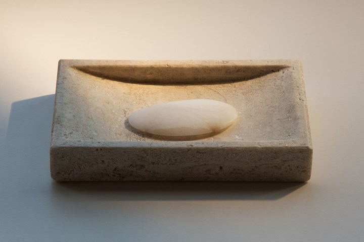 Trevor Yeung, Chicken Ribs (2018). Travertine, alabaster, hair. 8.6 x 13.2 x 2 cm. Courtesy the artist and Blindspot Gallery.