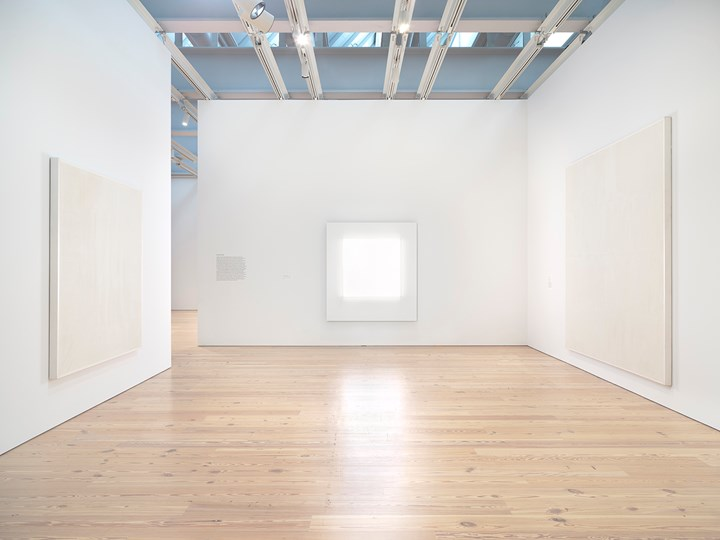 Exhibition view: Mary Corse: A Survey in Light, Whitney Museum of American Art, New York (8 June–25 November 2018). From left to right: Untitled (First White Light Series) (1968); Untitled (White Light Series) (1966); Untitled (White Grid, Vertical Strokes) (1969). © Mary Corse. Photograph by Ron Amstutz.