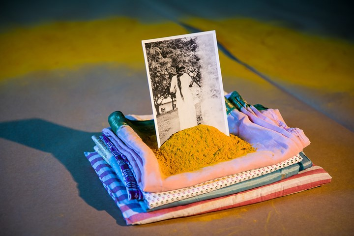 Shivanjani Lal, Khet (2018). (Detail) Mixed media installation, turmeric hand-died cloth, turmeric circle, brown paper, saris from women in the artist's family, photographs from the artist's Grandmother's archive. Exhibition view: Between Suns, Cement Fondu, Sydney (21 July–16 September 2018). Courtesy the artist and Cement Fondu. Photo: Anna Kucera.