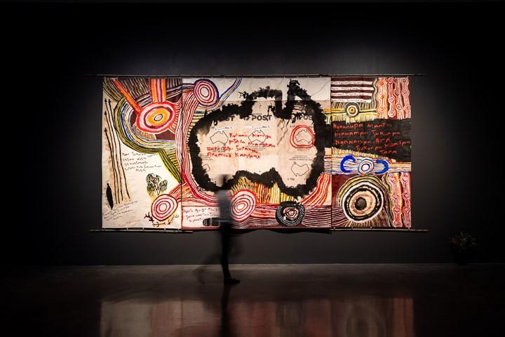 Kunmanara (Mumu Mike) Williams, Kamantaku Tjukurpa wiya. (The Government doesn't have Tjukurpa.) (2018). Synthetic polymer, ink and acrylic marker pen on canvas mailbags and linen, with kulata (spear) made from kulata (spearbush) and mulga, malu pulyku (kangaroo tendon) and kiti (mulga leaf resin). Exhibition view: The National 2019: New Australian Art, Museum of Contemporary Art Australia, Sydney (29 March–21 July 2019). © Kunmanara (Mumu Mike) Williams/Copyright Agency. Courtesy the artist and Mimili Maku Arts. Photo: Jacquie Manning.