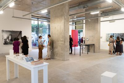 An exhibition opening features people gathering at the opening of Galerie Tanit's exhibition TOGETHERNESS in Beirut.
