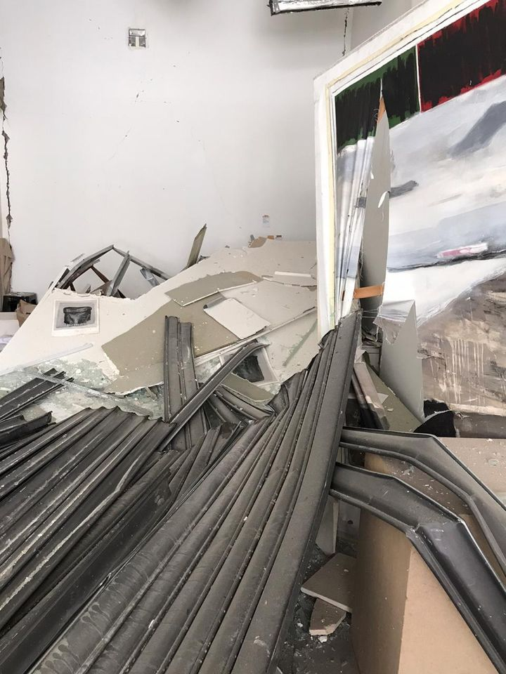 Rubble in Marfa' Projects as a result of the 2020 port blast is photographed up close.