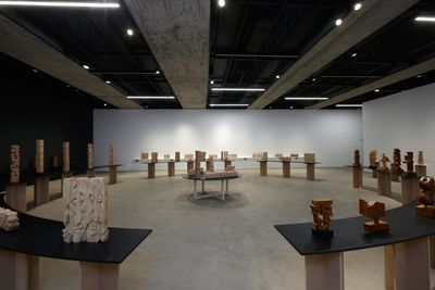 A circular structure of pedestals showcase a series of totemic sculptures by Joseph El Hourany showing in Saleh Barakat Gallery in Beirut.