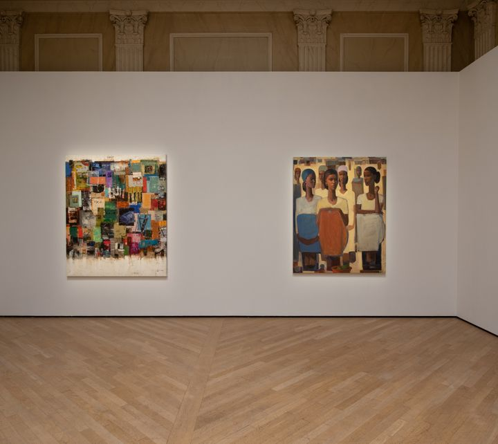 Patches of colour are rendered on a painting on a wall in the gallery space, which sits alongside another painting showing a group of women sitting.