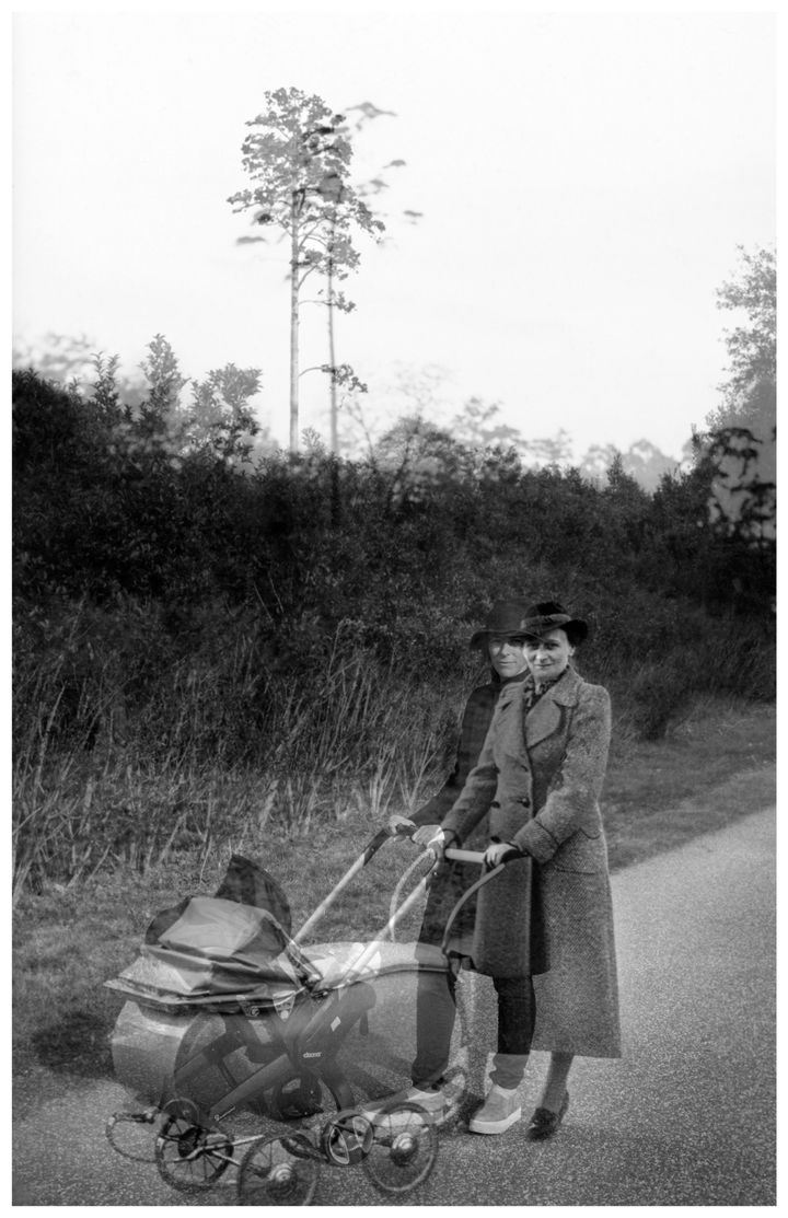 A black and white archival photograph features a woman pushing a pram. A double exposure effect overlays another image of a woman in modern attire also pushing a pram.