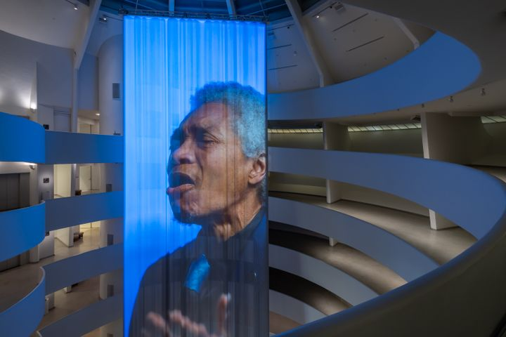Musician and transgender activist Beverly Glenn-Copeland is captured in a film installation by Wu Tsang in the rotunda of the Guggenheim. Glenn-Copeland is singing, projected onto a long curtain that hangs through the rotunda.
