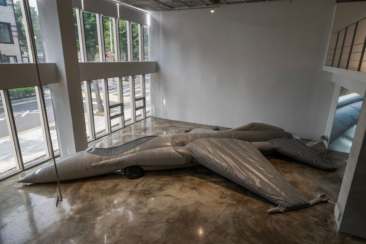 A decoy military aircraft lies deflated on the gallery floor, in Fiona Banner's exhibition at Barakat Contemporary in Seoul.