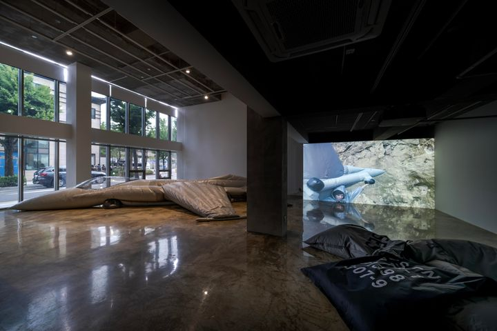 A deflated decoy military plane lies on the gallery floor at Barakat Contemporary in Seoul.