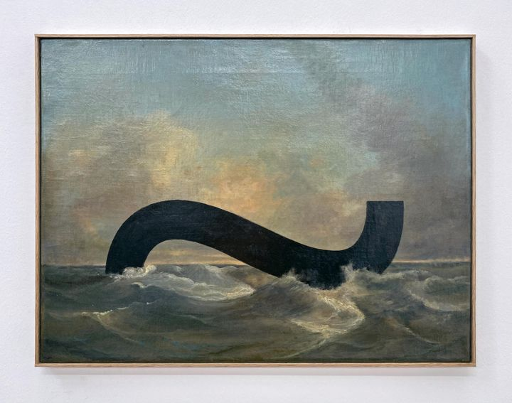 A framed painting of a choppy ocean features a black, curling line on its surface.