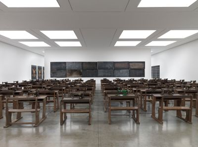 A series of sowing tables take up White Cube's exhibition space as part of Ibrahim Mahama's installation at the gallery.