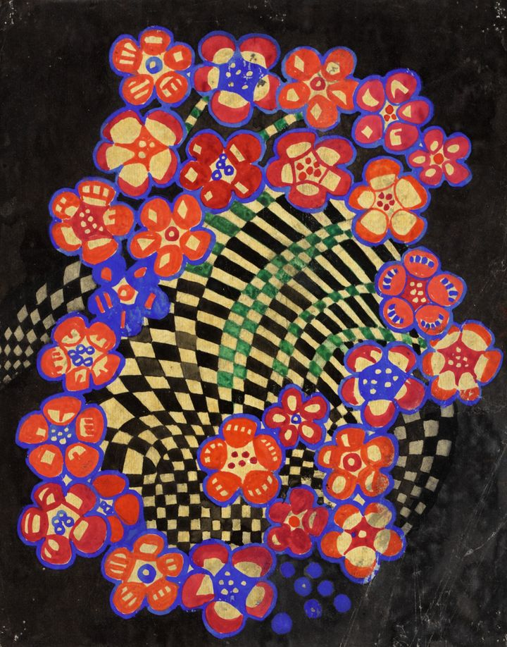 A geometric, multi-coloured pattern swirls on black background, with its central forms surrounded by a ring of flowers.