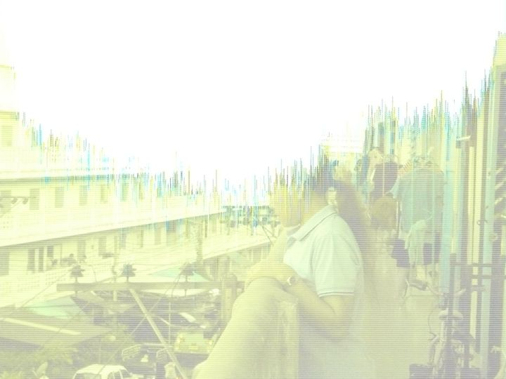 A glitched film still features a woman looking over a balcony.