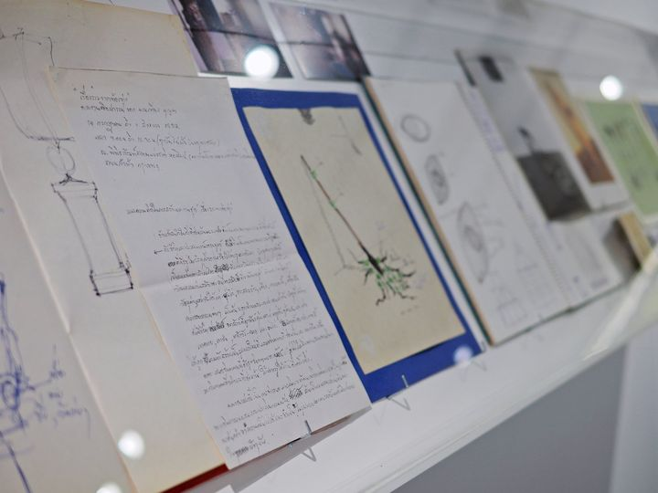 Close-up photo of an archive featuring prints and workbook pages by Thai artist Montien Boonma.