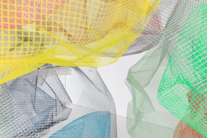 A close up of powder-coated mesh grids installation in a gallery space by artist Rana Begum