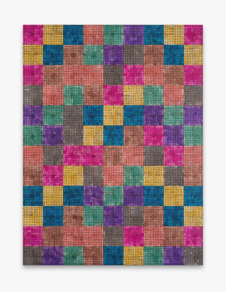 A grid of different coloured squares makes up a painting by McArthur Binion.