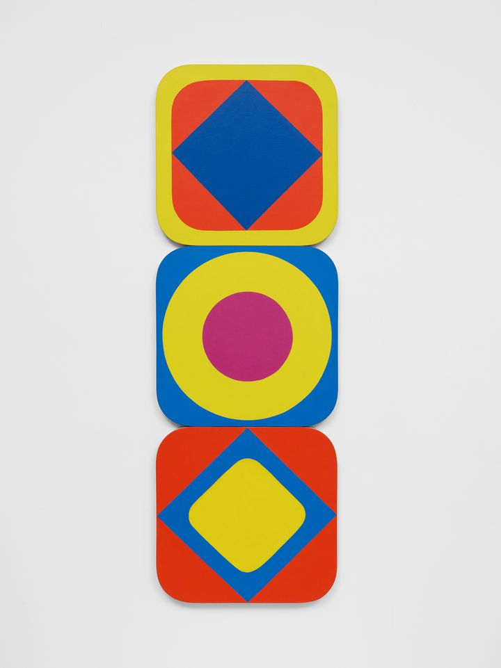 A line of stacked squares with rounded edges each feature pulsating circles within them in varying shades of yellow, blue, and red.