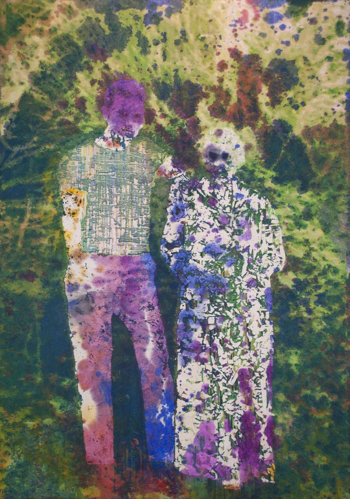 A multi-coloured image, featuring pools of colour that resemble stains, outlines two figures standing in the centre of the frame.