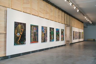 A series of large, colourful paintings by Jaider Esbell depict allegorical scenes about the Kanaimés, spirits related to Macuxi culture. They line one wall of the Bienal exhibition space.