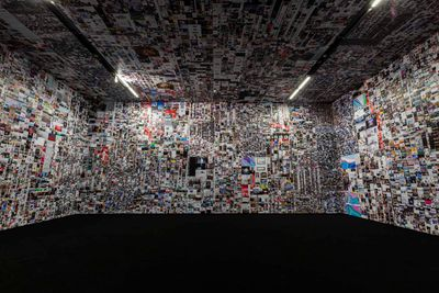 The walls and ceiling of a gallery space is filled with images from the internet, in an installation by Evan Roth.
