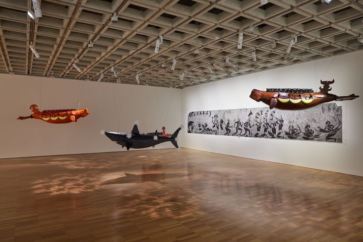 Alick Tipoti, Dhangal Madhubal and Baydham (both 2021). Fibreglass resin, rope, beads, acrylic. Installation dimensions variable. Courtesy the artist. Girelal (2011). Single-block vinyl cut printed in black ink on paper. 120 x 825 cm. Cairns Art Gallery, Queensland, donated through the Australian Government's Cultural Gifts. Program by Editions Tremblay, 2012. Courtesy the artist and Cairns Art Gallery. Exhibition view: The National 2021: New Australian Art, Art Gallery of New South Wales, Sydney (26 March–5 September 2021). Photo: AGNSW, Felicity Jenkins.