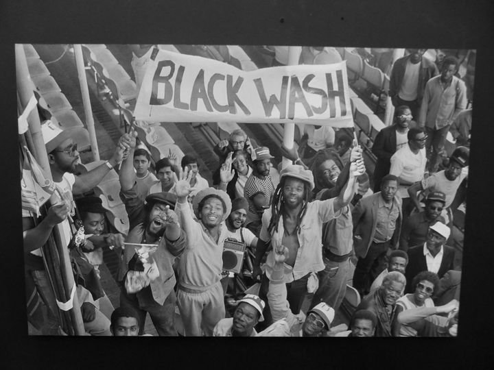 Artwork depicting black people protesting holding a sign saying Black Wash, from the exhibition War Inna Babylon at Institute of Contemporary Art