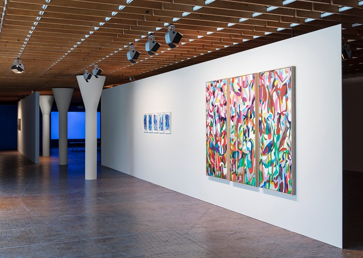 Herman Mbamba, The blue mandane series 1–5 (2017–2018). Acrylic and watercolour on paper; Wait for me in the lurking landscape (2017–2018). Triptych. Acrylic and oil on canvas (left to right). Exhibition view: We don't need another hero, 10th Berlin Biennale for Contemporary Art, Akademie der Künste, Berlin (9 June–9 September 2018). Courtesy the artist and blank projects, Cape Town. Photo: Timo Ohler.