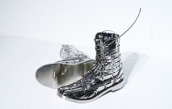 Tayeba Begum Lipi, The Colombian Boots (2018). Stainless steel. 27.94 x 15.2 x 8.9 cm. Courtesy the artist.