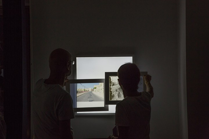 Viewers engage with Jack Persekian's project Jaffa Gate and Mamila at the Lutheran School. Exhibition view: Jerusalem Actual & Possible, The Jerusalem Show IX, Lutheran School, Jerusalem (3–31 October 2018). Courtesy Qalandiya International.