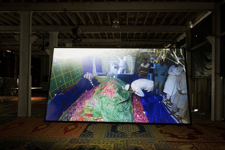 Khaled Sabsabi, Bring the Silence (2018) (Detail). Five-channel HD video installation with audio. 11 min 30 sec, infinite loop. Originally commissioned by the Sharjah Art Foundation and filmed with the permission of the custodians of the Maqām of Hazrat Khwaja Syed Nizamuddin Auliya, New Delhi. Exhibition view: SUPERPOSITION: Equilibrium & Engagement, 21st Biennale of Sydney, Cockatoo Island (16 March–11 June 2018). Presentation at the 21st Biennale of Sydney was made possible with generous support from the Andrew Cameron Family Foundation and the Australia Council for the Arts. Courtesy the artist and Milani Gallery, Brisbane. Photo: silversalt photography.