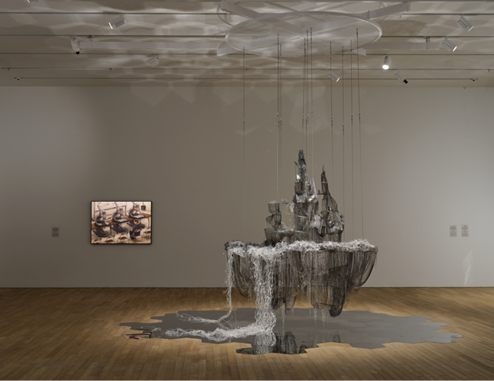 Left to right: Tetsuya Ishida, Interview (1998). Acrylic on board. 103 x 145.6 cm; Lee Bul, After Bruno Taut (Beware the sweetness of things) (2007). Crystal, glass, and acrylic beads on stainless-steel armature, aluminium and copper mesh, PVC, steel, and aluminium chains. 258 x 200 x 250 cm. Exhibition view: Phantom Plane, Cyberpunk in the Year of the Future, Tai Kwun Contemporary, Hong Kong (5 October 2019–4 January 2020). Courtesy the artists, Galerie Thaddaeus Ropac, and Tai Kwun Contemporary.