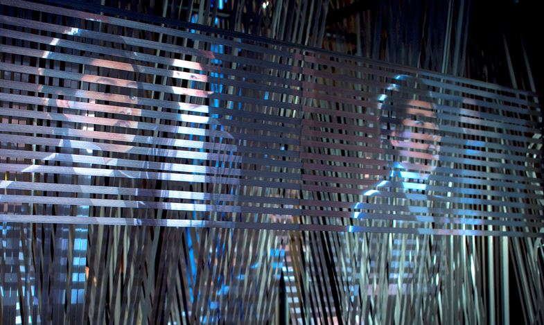 Erika Tan, The 'Forgotten' Weaver, (2017). Video installation with the strap weaving and the metal structure. 700 x 2100 x 2115mm, 19 min 47 sec loop. Courtesy of the Artist