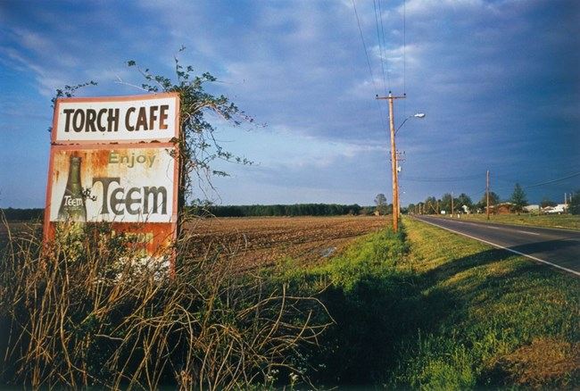 Untitled (Torch Cafe Billboard) Mississippi [From Dust Bells 2] by William Eggleston contemporary artwork