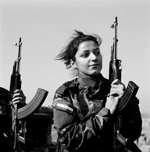 Portrait of Peshmerga, Nishtman, 24 years old, serving under Hussein Yazdanpana's command in the Kurdistan Freedom Party (PAK), fighting Daech along the enemy line, Northwest Kirkuk, Iraqi Kurdistan, 20 November 2015 by Katharine Cooper contemporary artwork