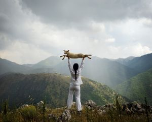 Holding the Lamb (from the series: Back to Simplicity) by Marina Abramović contemporary artwork photography
