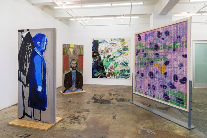 Exhibition view:Dona Nelson,models stand close to the paintings, Thomas Erben Gallery, New York (17 March–6 May 2017). Courtesy Thomas Erben Gallery.