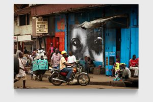 28 Millimètres, Women are Heroes, Downtown Monrovia, Liberia by JR contemporary artwork