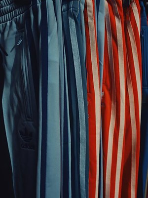 FRANCE. Sete. Track suits for sale at the market. by Christopher Anderson contemporary artwork