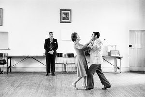 Dancing-master, Ted van Rensburg, watches two of his ballroom pupils swinging to a recording of Victor Sylvester and his Orchestra, in the MOTHS' Hall at the old Court House by David Goldblatt contemporary artwork