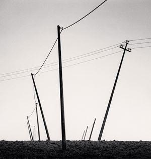 Ten Slanted Poles by Michael Kenna contemporary artwork
