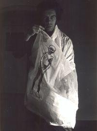 "Hélio Oiticica wearing P22, Cape 18 ""Nirvana"" - Parangolé by Hélio Oiticica contemporary artwork photography"