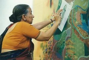 Nilima Sheikh applying stencil on her work by Nilima Sheikh contemporary artwork photography