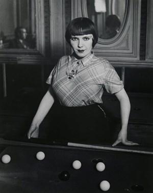 Girl playing Russian billiards, Boulevard Rochechouart by Brassai contemporary artwork