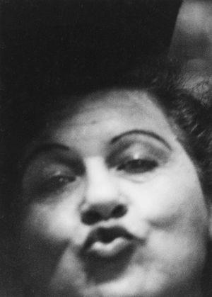 Woman making a kissy face, Sammy's Bowery Follies, N.Y.C. 1958 by Diane Arbus contemporary artwork