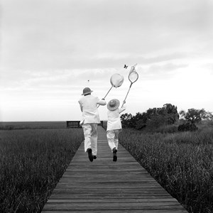 Gary and Henry Chasing Butterfly, Beafort, SC by Rodney Smith contemporary artwork