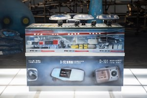Shenzhen Mass Entrepreneurial Huaqiangbei market counter in OCT theme park style: vehicle data recorder by Simon Denny contemporary artwork