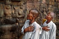Buddhist nuns at the Leper King Terrace, Angkor Wat, Cambodia by Steve McCurry contemporary artwork photography