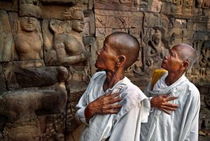 Buddhist nuns at the Leper King Terrace, Angkor Wat, Cambodia by Steve McCurry contemporary artwork